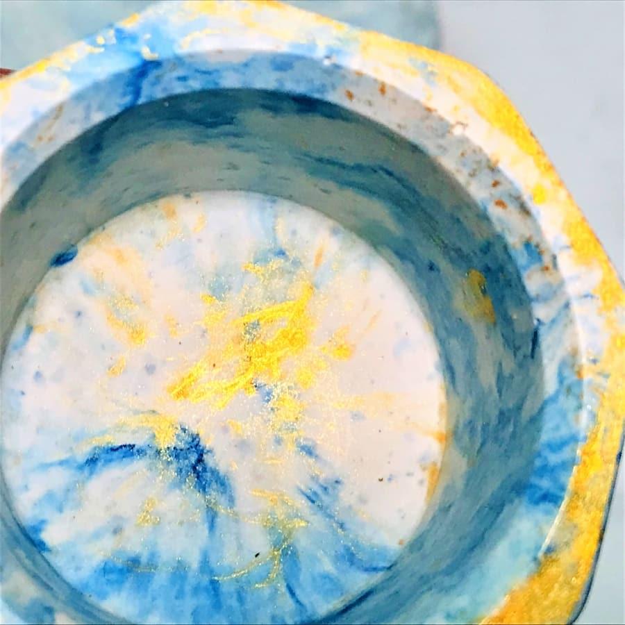 tea light blue gold closeup