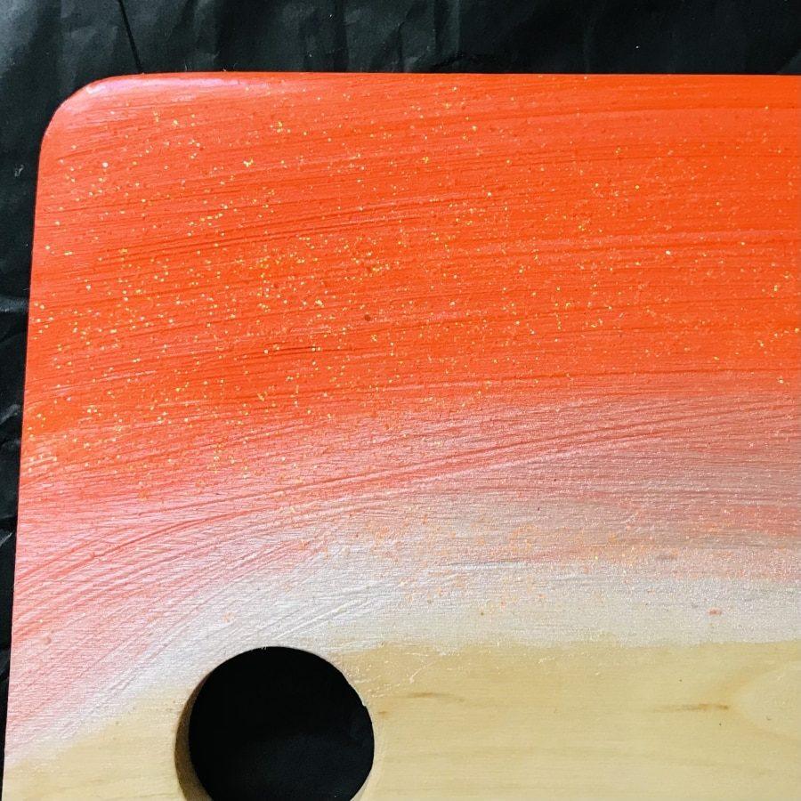 orange resin wooden chopping board close up