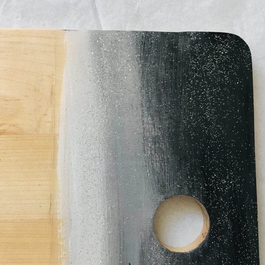 black silver grey wooden chopping board close up
